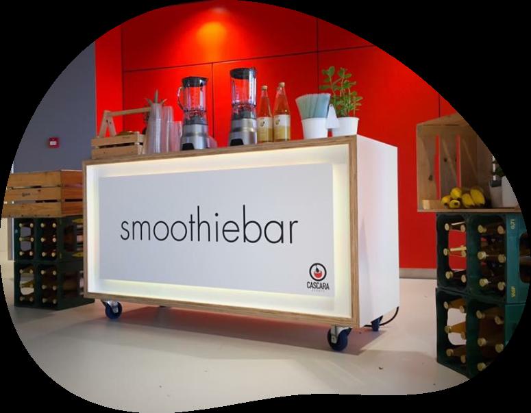 Een mobiele smoothie bar met persooneel